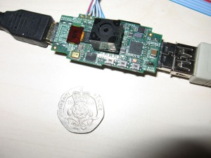 Photo of Raspberry Pi next to a 20p